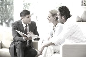 Salesman talking to couple about services