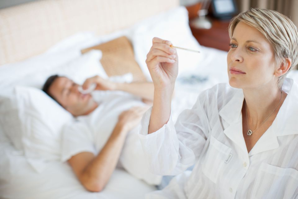 Wife taking sick husbands temperature