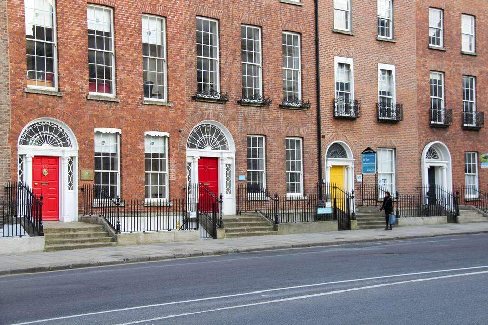 Dublin's famous colourful doors, built in the 18th century following a strict Georgian architectural style. Many of these houses have survived to this day and have now become visual landmarks of Dublin. Seen at Merrion Square, Dublin, Ireland