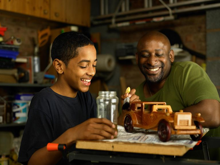 Father admiring Son's woodwork project