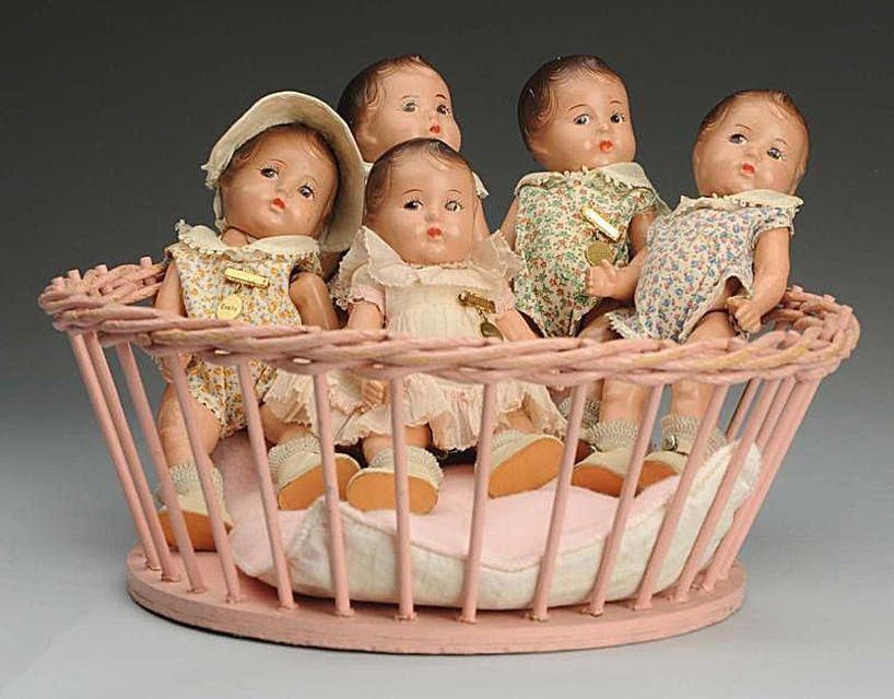 Set of Dionne Quintuplets dolls by Madame Alexander. Sold for $510 at Morphy Auctions in May of 2011.