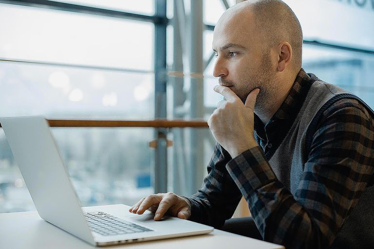 Man working by computer