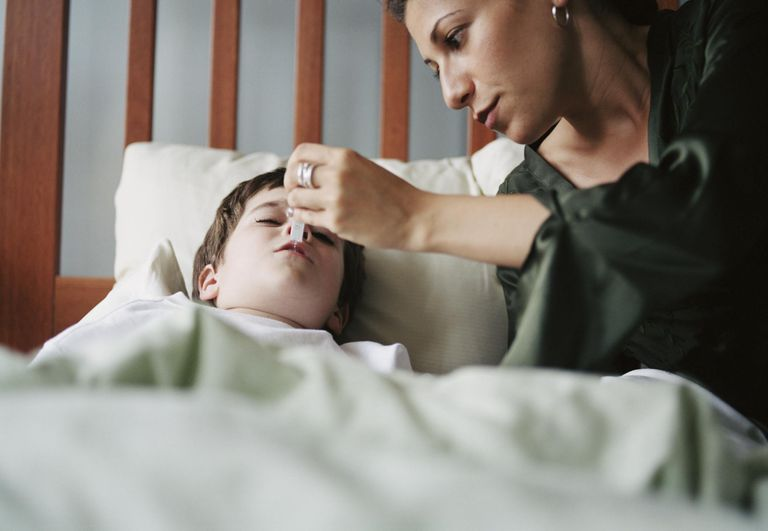 Mother taking child's temperature