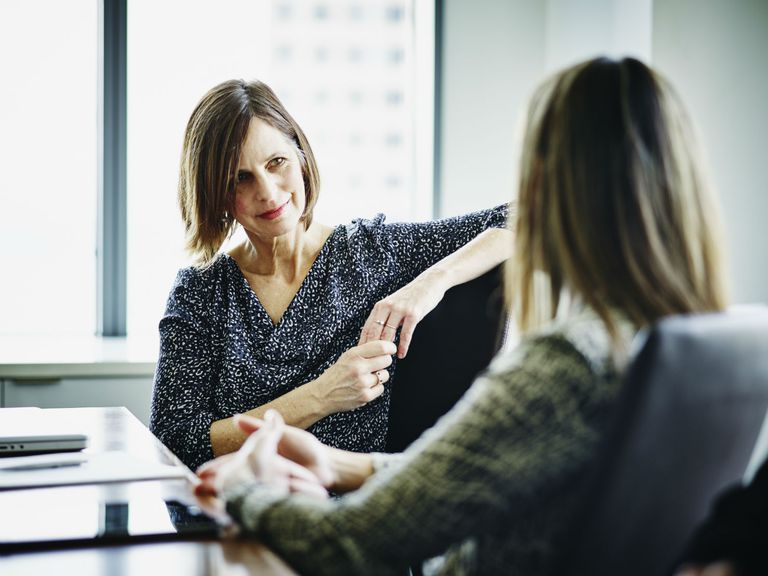 Experienced businesswoman in a mentoring conversation with younger businesswoman