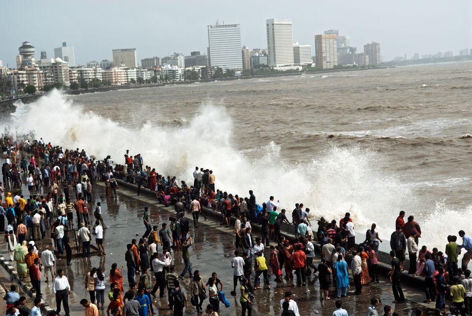 People enjoying hightide waves at marine drive, Bombay, Mumbai, Maharashtra, India