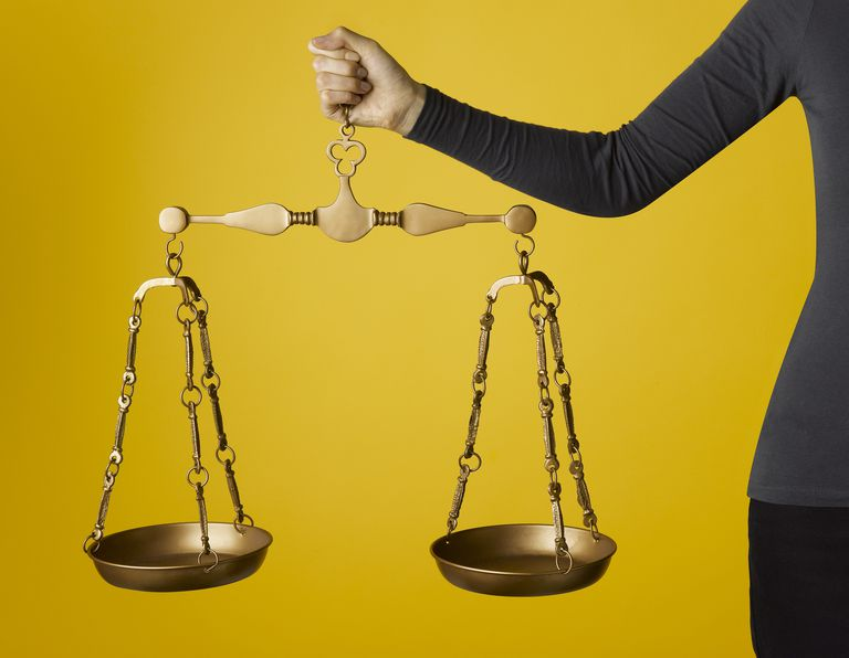 Woman holding justice scales