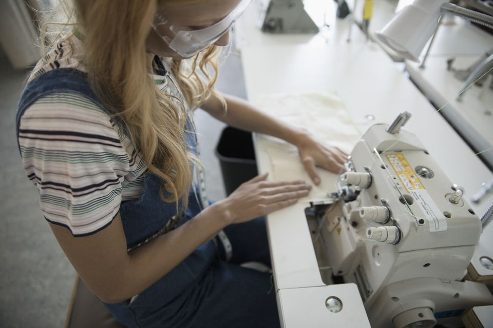 woman sewing on serger