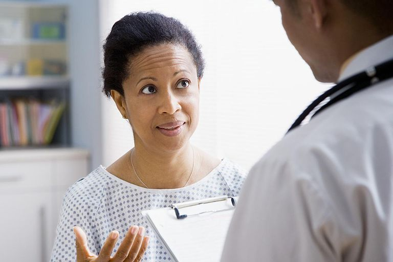 Female patient talking with doctor