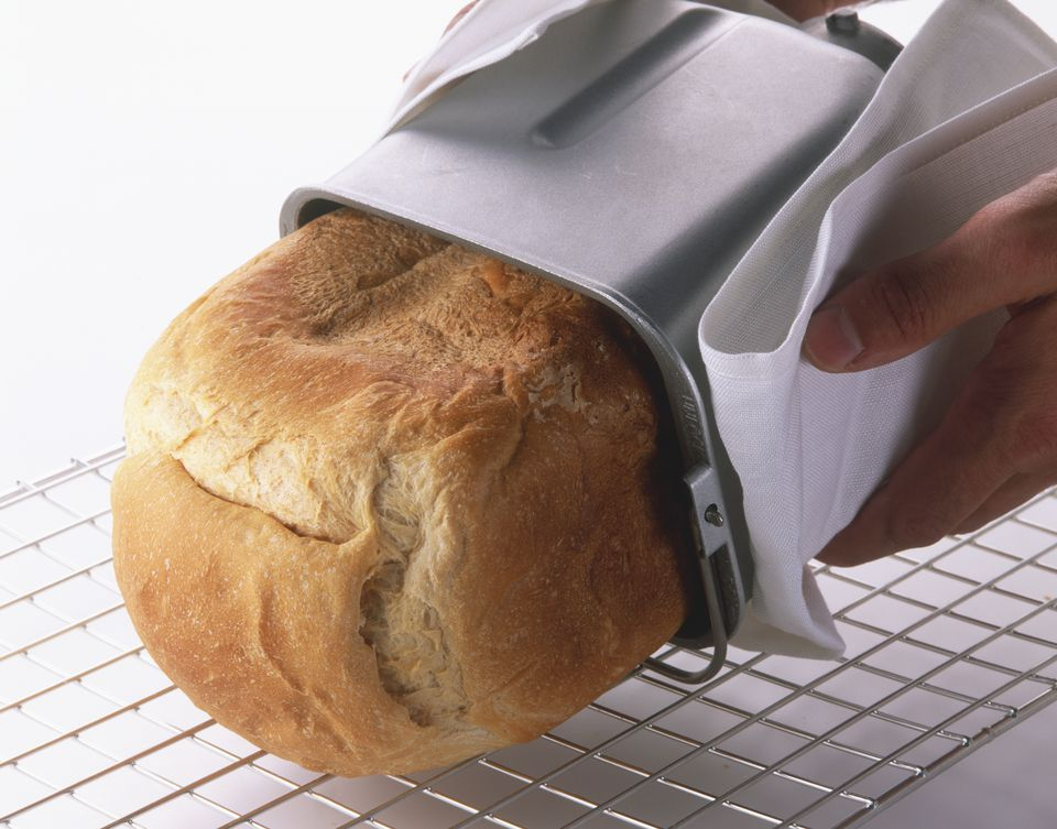 Easing baked bread loaf from bread making machine