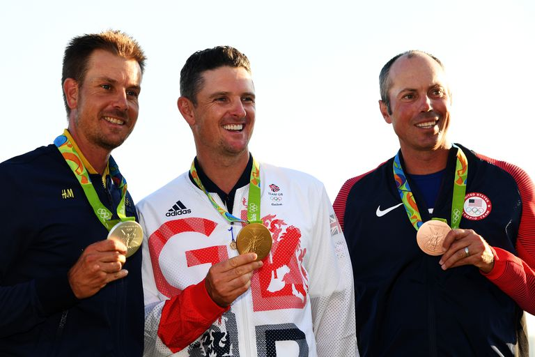 Justin Rose (C) of Great Britain celebrates with the gold medal, Henrik Stenson (L) of Sweden, silver medal, and Matt Kuchar of the United States, bronze medal, after the final round of men's golf on Day 9 of the Rio 2016 Olympic Games