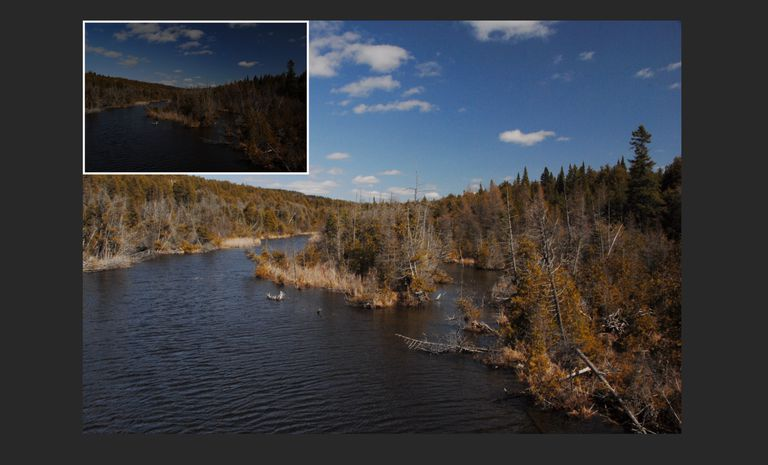 The underexposed image is shown in the upper left corner of the corrected image.