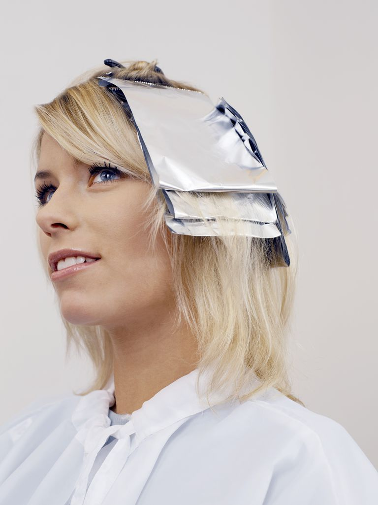 Woman dying her hair blonde