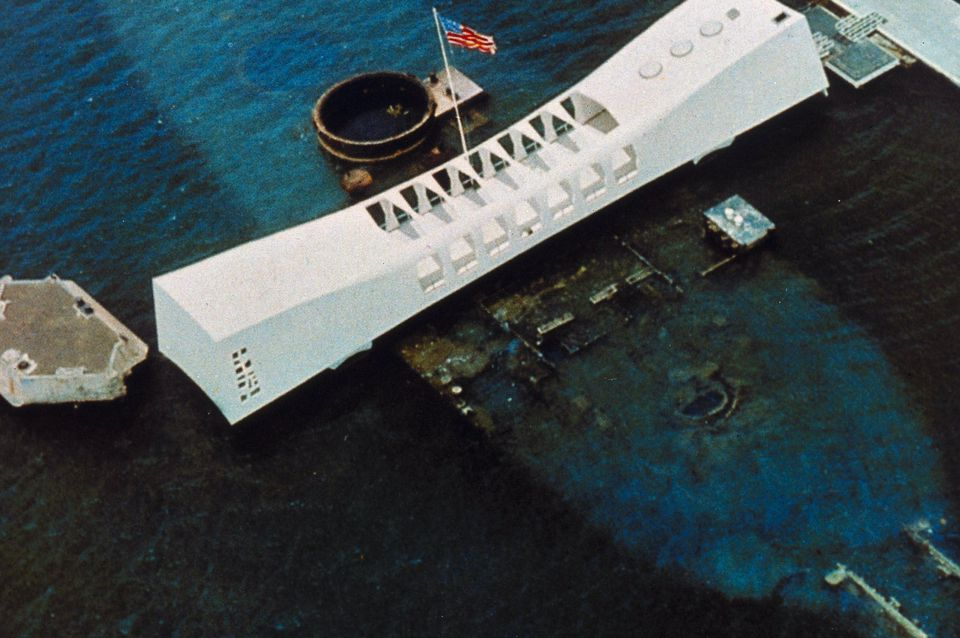 Bright white USS Arizona National Memorial over the sunken hull of the Battleship Arizona, c. 1962
