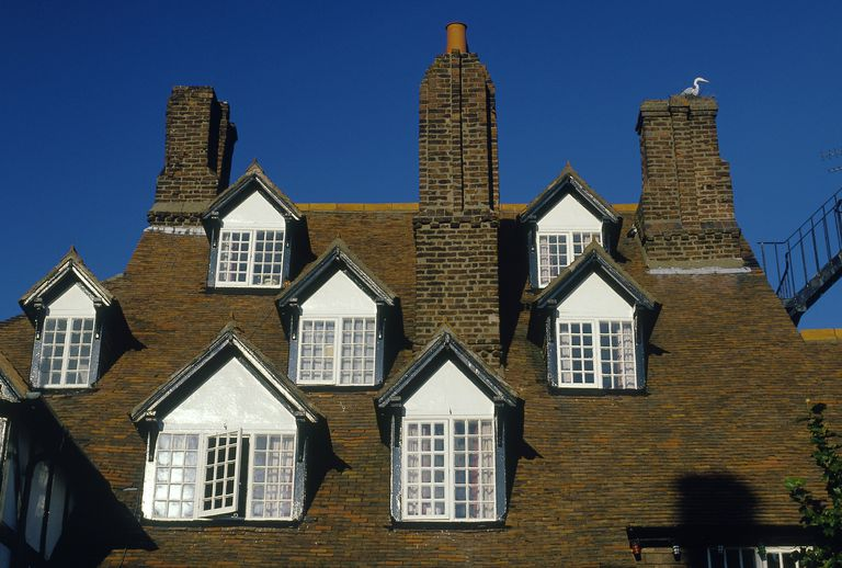 Seven dormers and three chimneys on a 16th century Welsh roof