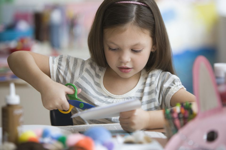 Young girl working on arts and crafts