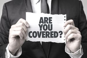 "man holding a paper with the words ""Are You Covered?"""