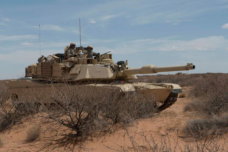 U.S. Soldiers with the 1st Battalion, 6th Infantry Regiment, move their M1 Abrams tank into a defensible position during a simulated battle at Network Integration Exercise 13.2 near Dona Ana, N.M., May 7, 2013.
