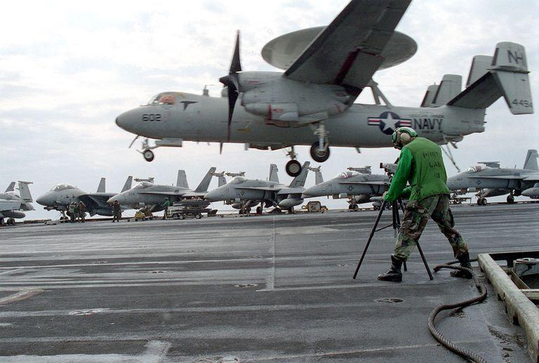 Photographers Mate 3Rd Class Dan Bassett Shoots Video Of An E2 C Hawkeye Landing On The Flight Deck