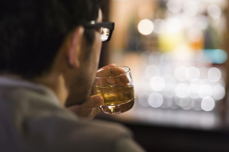 Man in bar sipping cocktail