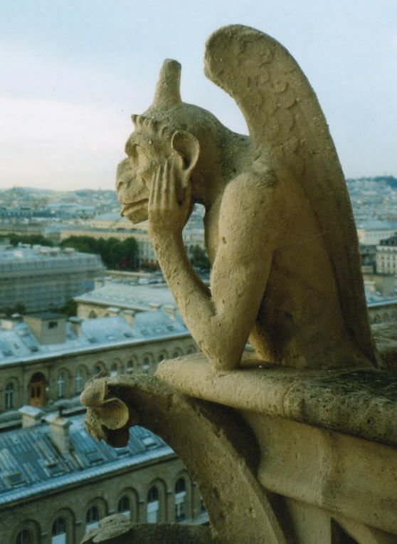 A gargoyle atop Notre Dame Cathedral contemplates life. Photo © Teresa Plowright.