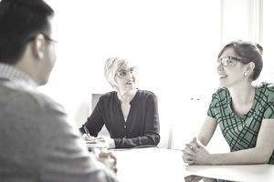 Smiling senior businesswoman leading discussion