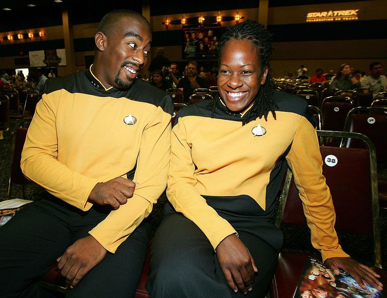 African American man and woman in yellow Star Trek costumes