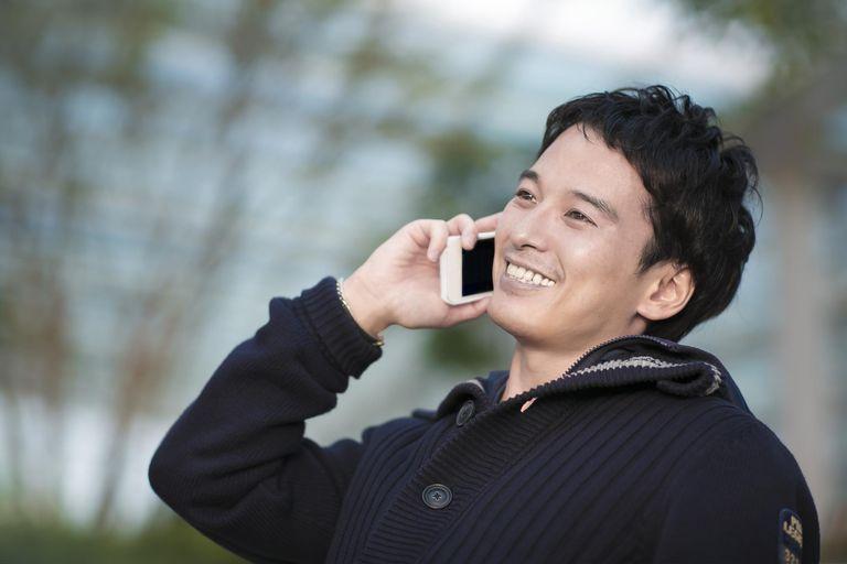 Portrait of businessman talking cell phone