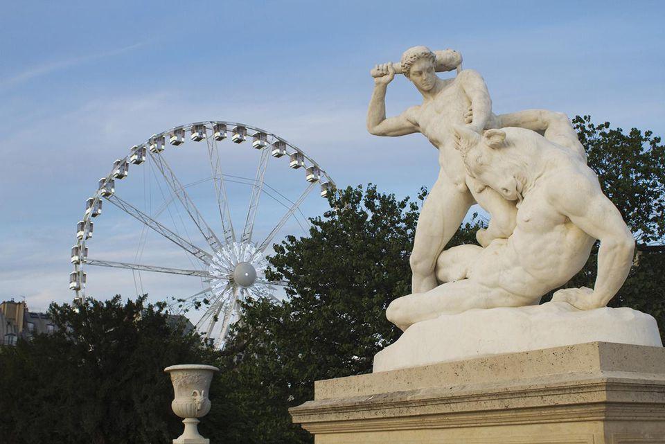 France, Paris, Jardin des Tuileries, statue of Theseus fighting the Minotaur and ferris wheel