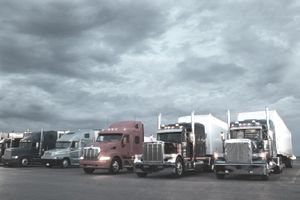 Semi-trucks parked at truck stop, dawn
