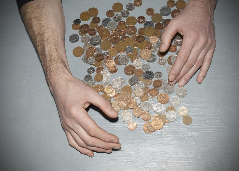 Hands gathering money
