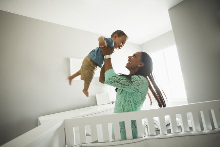 Woman holding her baby up
