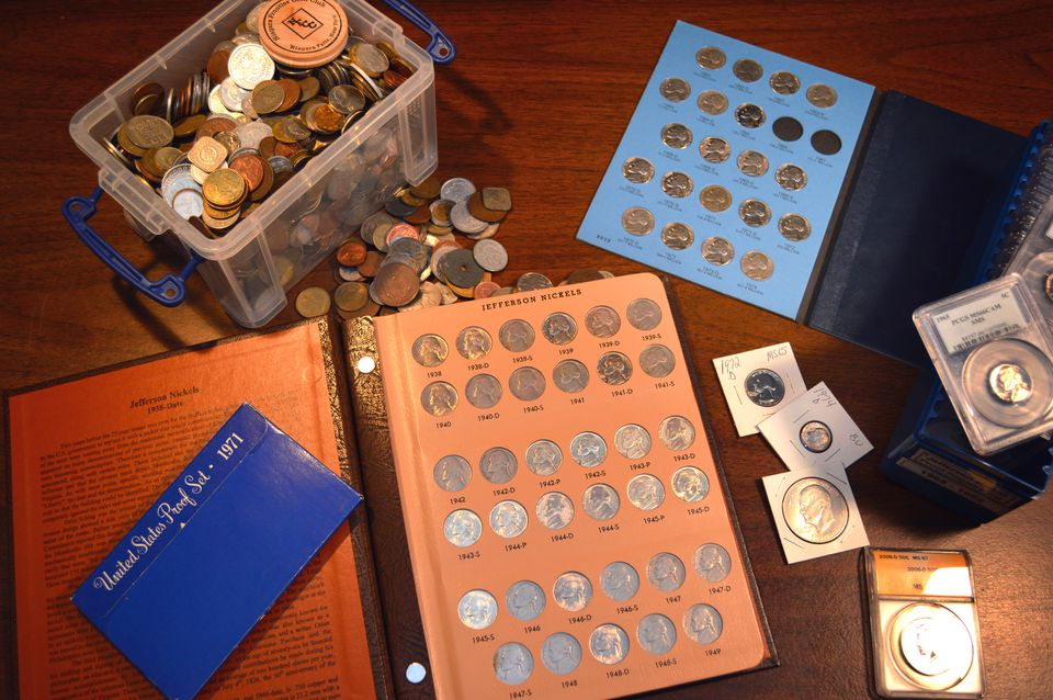 A coin collection in albums, folders, slabs, etc.