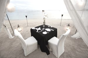 Couple enjoying romantic vacation on the beach - personal liability coverage for accidents