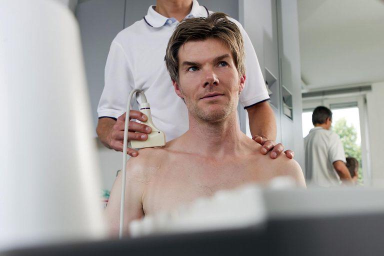 Doctor using sonogram on patient