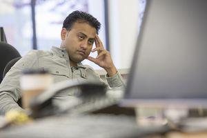 Man looking anoyed at computer