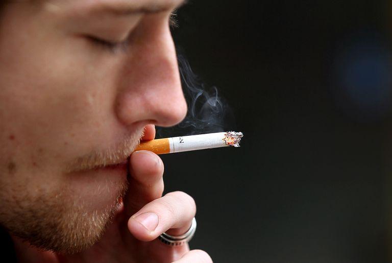 Man smoking cigarette.