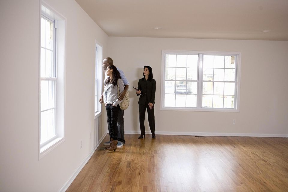 Realtor showing couple new home