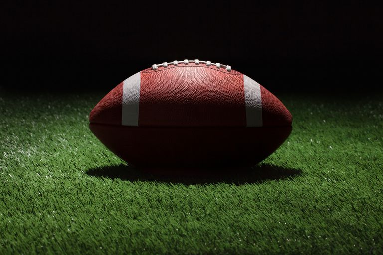 Close-Up Of American Football Ball On Field