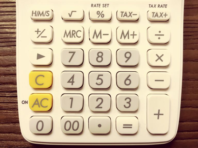 High Angle View Of Calculator On Table