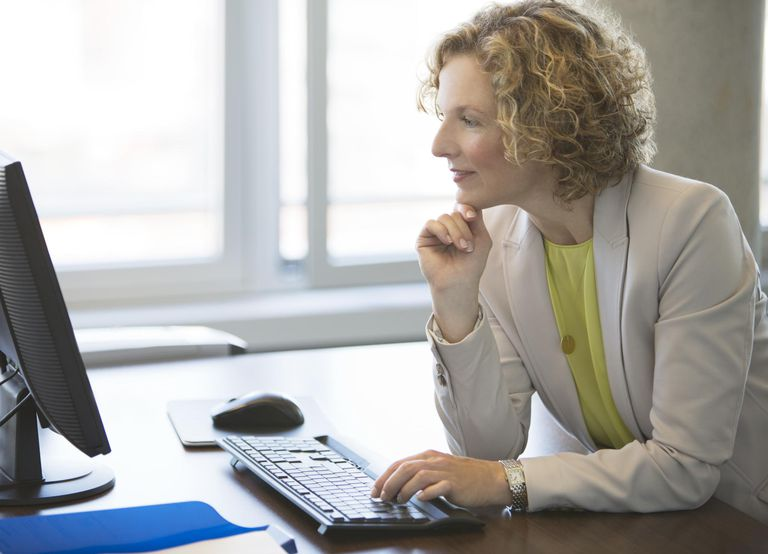 Businesswoman working at computer at desk
