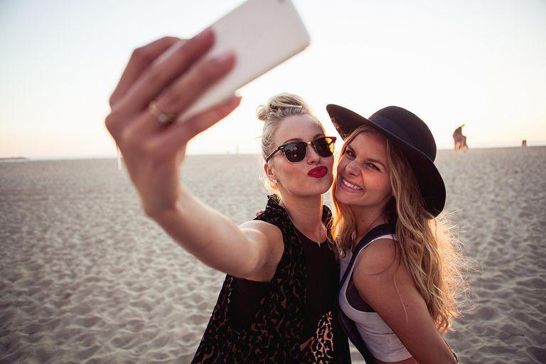 Two Women Taking a Selfie on the Beach