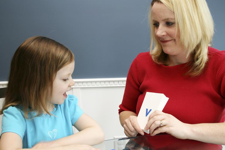 child learning with flash cards