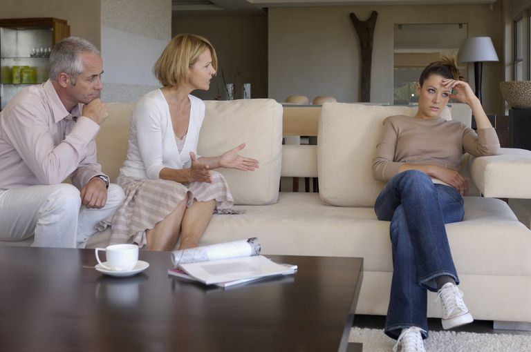 Parents arguing at teenage daughter
