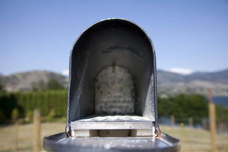 Old open mailbox close up, British Columbia, Canada