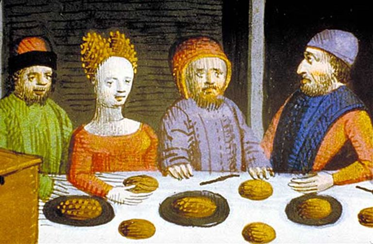 Diners enjoying frumenty porridge