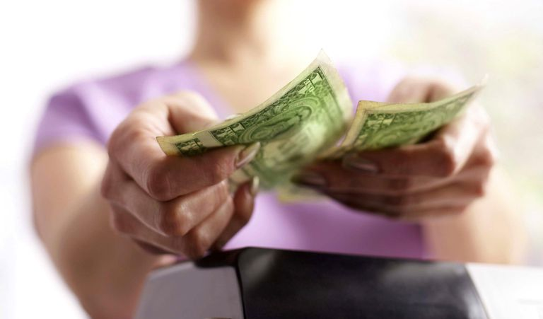 Cashier holding money