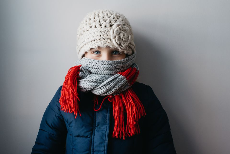 Girl warmly wrapped up in woollen hat and scarf