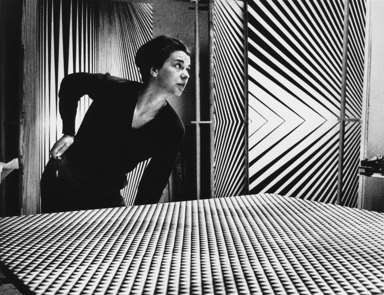 British Op Art painter Bridget Riley with some of her works.