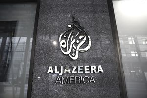 A photo of the Al Jazeera America logo outside its building in New York City.