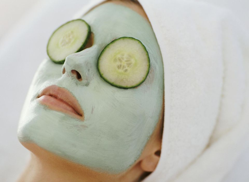 Young Woman Lying Down With a Face Pack